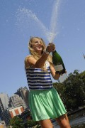 Виктория Азаренко, фото 197. Victoria Azarenka Posing with the Australian Open Trophy along the Yarra River in Melbourne - 29.01.2012, foto 197