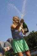 Виктория Азаренко, фото 197. Victoria Azarenka Posing with the Australian Open Trophy along the Yarra River in Melbourne - 29.01.2012, foto 197